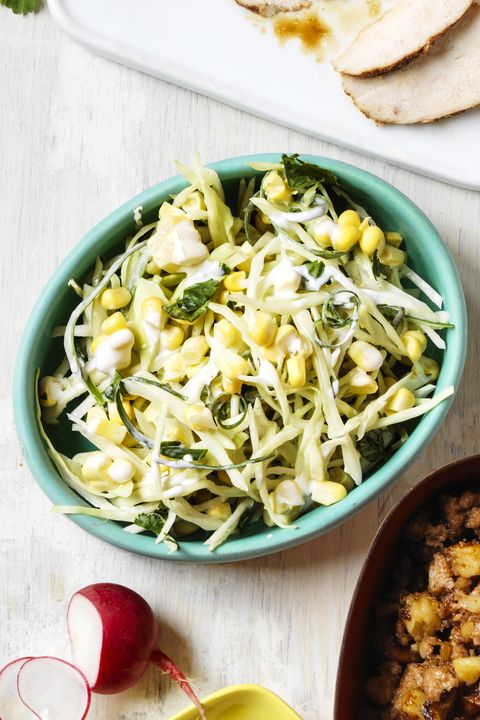 cabbage slaw tossed with corn and a creamy dressing