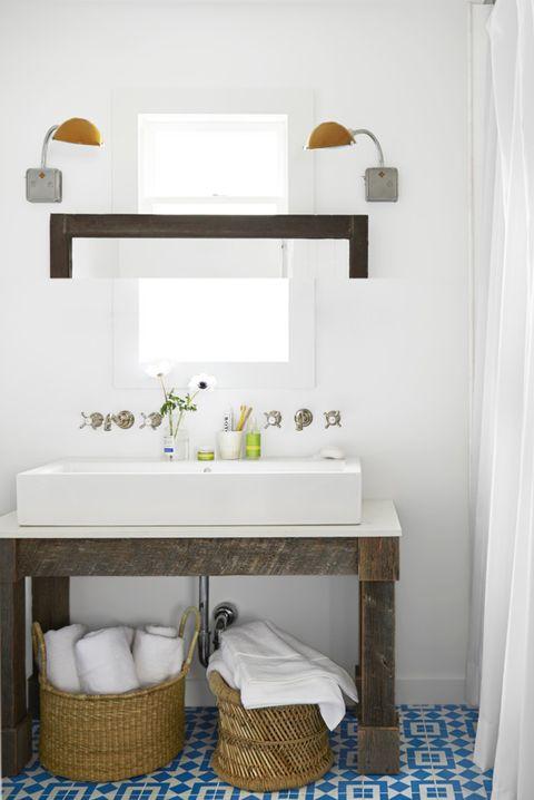 bathroom with baskets under sink