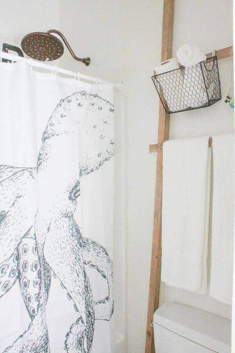 small bathroom storage ideas - ladder over toilet storage