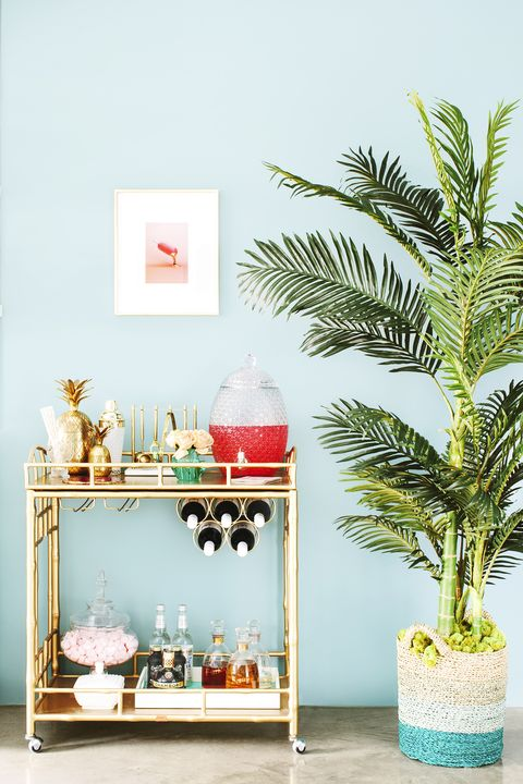 living room bar cart and plant