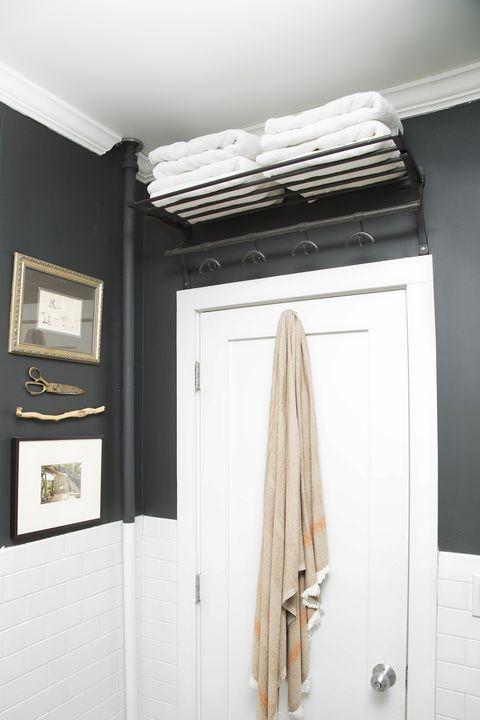 small bathroom storage ideas - over door shelves