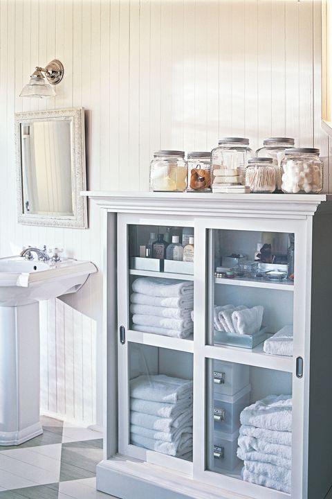 shallow cabinet and glass canisters