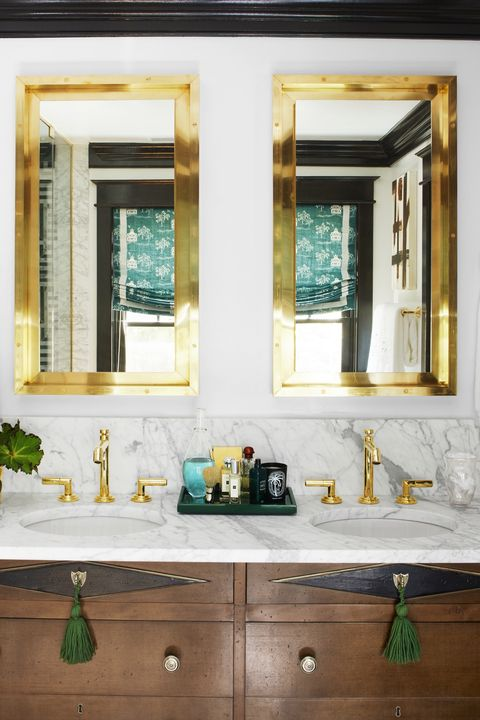 gold mirrors and bathroom vanity