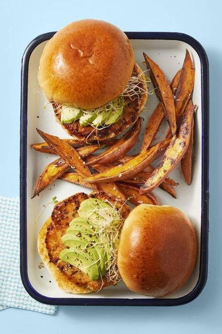 salmon burgers topped with sliced avocado and sweet potato fries recipe