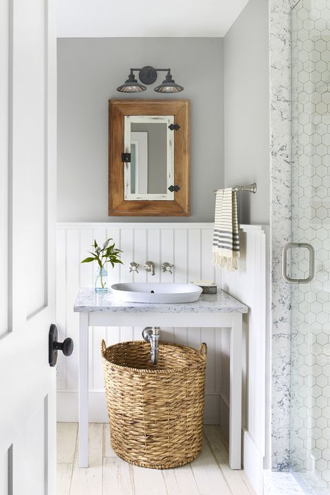 bathroom with wall mounted faucets